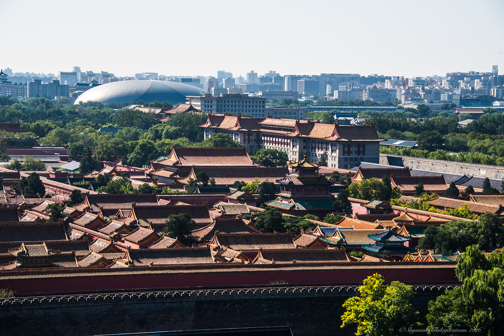 A small part of the Forbidden City with modern Beijing in the background