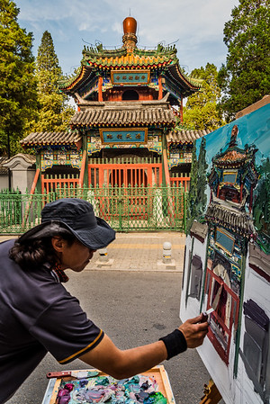 Artist at work outside Niujie Mosque at Ox Street.
