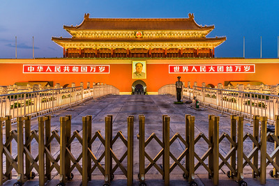 The Gate of Heavenly Peace (Tiananmen) brightly lit at dusk.