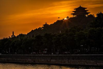 Sunset behind Jingshan pagoda.