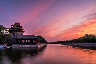 View of Forbidden City and Jingshan pagoda at sunset.