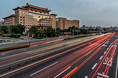 View of the Jing Du Yuan Hotel and the traffic on East 2nd Ring Road at dusk.
