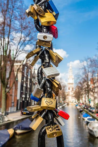 THE NETHERLANDS-AMSTERDAM-MAGERE BRUG [skinny bridge]-BICYCLE LOCKS