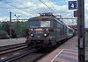 SNCB 2306 heads south through Antwerpen Noorderdokken on 24 May 2005 with a very mixed freight including a passenger coach!