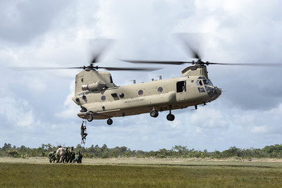 Belize Defense Force (BDF) members practice climbing in and out of a U.S. Army CH-47 Chinook helicopter during a training mission held in Belize, Oct. 26, 2015. BDF and the Army will be working together to eradicate marijuana fields throughout Belize during the next four days. (U.S. Air Force photo by Senior Airman Westin Warburton/Released)