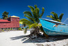 An abondoned boat and cottage on the island of Caye Caulker, Belize.