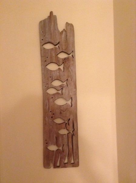 Fish profiles in driftwood, approx. 4' tall