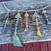 Fish stringer, driftwood and washed up coral pieces