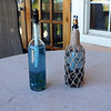 Citronella oil torches for bug repelling, old wine bottles
