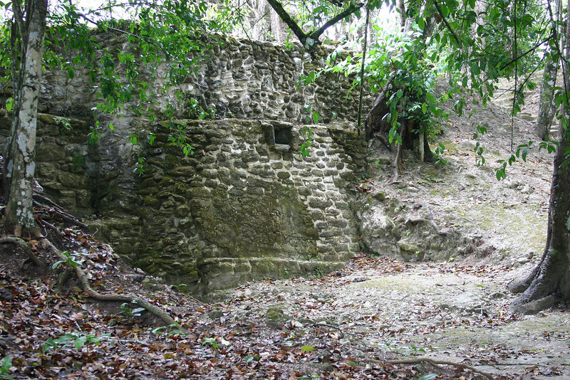 The drain at the center of the structure suggests it may have been a bath or sweat house.