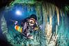 side mount cave diver in Belize
