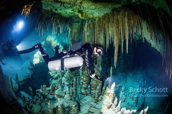 Side mount cave diver explores hidden worlds