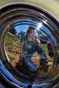 Madeleine posing in the hubcap.  Canon 5D Mark II with EFL 24 - 105. f4.  Brigitt suggested this reflection shot to me.  Great job!