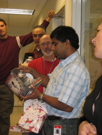 ... so Bhupal opens a new gift ... A snowman decoration ...