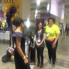 """""""Belle"""" Cassandra Pires of Roxbury checks out her dress in the mirror, as personal shoppers Michelle Block of Malden, center, and Laticia Tolentino of Milton, volunteer captain of the """"Belle of the Ball"""" for 13 years, are all smiles."""
