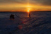 People on the ice of the Bay of Quinte at sunrise.