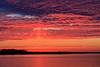 Sun pillar down the Bay of Quinte before sunrise.