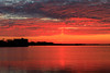 Wider view of sky and Bay of Quinte before sunrise from causeway of former Bay Bridge. Sun pillar and reflection.