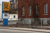 """Hotel Quinte, remains after fire. What is standing is to be demolished. Sign reads """"Hotel Opennin"""""""