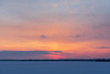 Low clouds across the Bay of Quinte show red patches just before sunrise.
