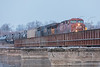 AC4400CW locomotive CP 9831 leads an oil train across the Moira River in Belleville Ontario. Canadian Pacific Railway.