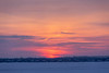 Low clouds partially obscure the rising sun at sunrise across the Bay of Quinte 2018 December 31.