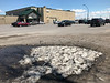 Snow mound in Bayview Mall parking lot shrinking