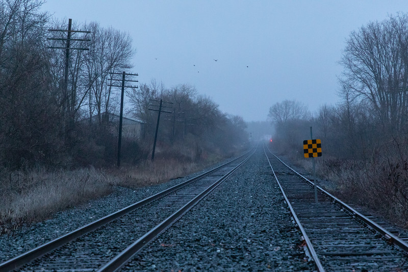 Looking east along the Canadian Pacific tracks from Herchimer Avenue on a foggy morning.