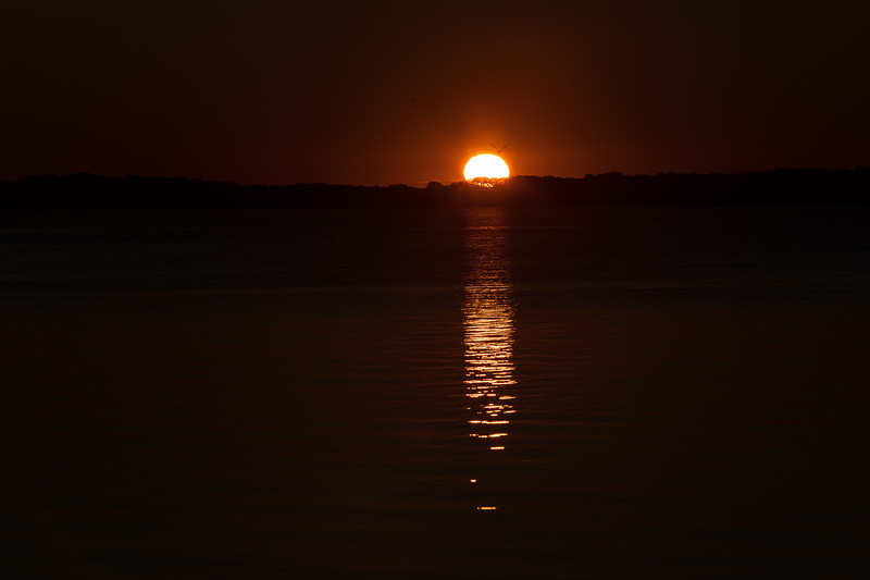 Sun's reflection on the water of the Bay of Quinte. Darker exposure