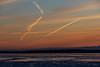 Contrails over the south shore of the Bay of Quinte before sunrise.