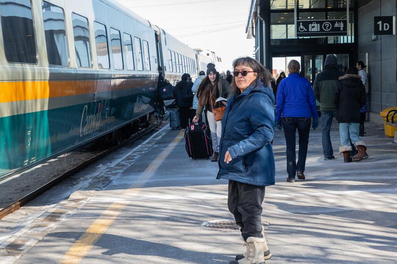 Railfan Denise Lantz at Belleville Ontario station with VIA train 64.