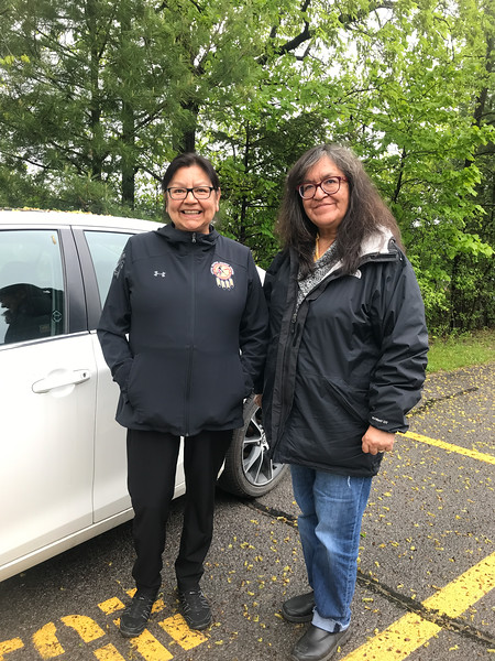 Patricia Faries and Denise Lantz in parking area.