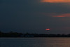 Red sun peering through low clouds over the Bay of Quinte.