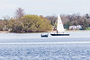 Fishing boat and sail boat down the Bay of Quinte.