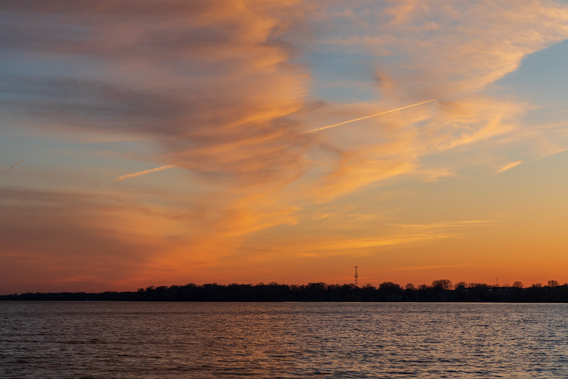 Clouds and contrail after sunset.
