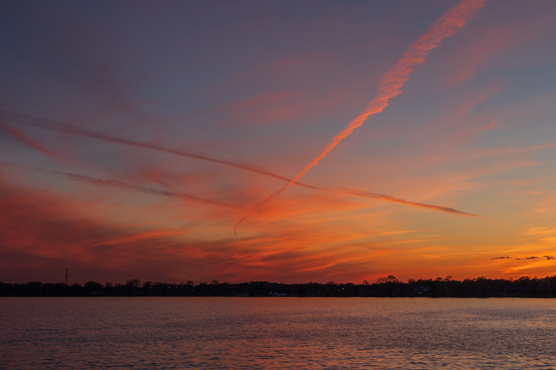 Contrails after sunset over the Bay of Quinte at Belleville Ontario 2019 May 17