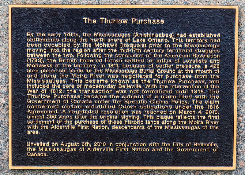 Thurlow Purchase monument commemorating  settlement of the purchase of lands along the Moira River with the Alderville First Nation. Crop showing plaque text