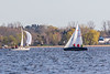 Sailboats passing across the Bay