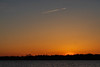 Contrail across the Bay of Quinte after sunset.