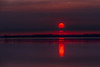 Red sun rising across the Bay of Quinte HDR efx dark.