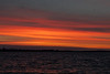 Orange and purple skies along the horizon down the Bay of Quinte before sunrise at Belleville Ontario 2020 April 29