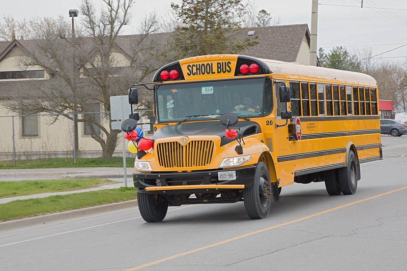 School bus parade organized by Parkhurst Transportation to honour healthcare workers and first responders. Seen on Herchimer Avenue.