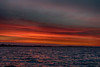 Orange and purple skies along the horizon down the Bay of Quinte before sunrise at Belleville Ontario 2020 April 29 HDR efx dark from three exposures