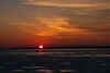 Rising sun reflected on the ice of the Bay of Quinte