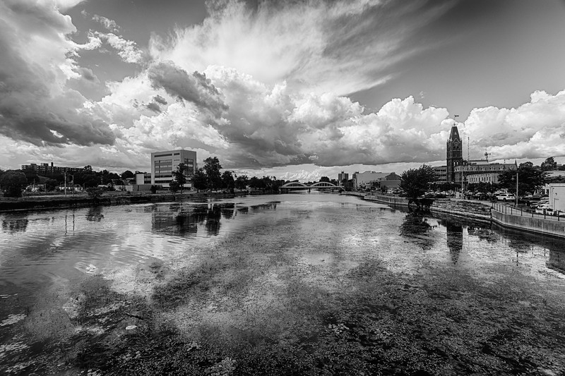 View up the Moira River with Quinte Consolidated Court House at left and Belleville City Hall at right as clouds move in 2020 July 30 HDR efx balanced simulated Kodalith
