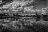 View up the Moira River with Quinte Consolidated Court House at left and Belleville City Hall at right as clouds move in 2020 July 30 HDR efx black and white artistic