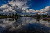View up the Moira River with Quinte Consolidated Court House at left and Belleville City Hall at right as clouds move in 2020 July 30 HDR efx dark shadows +50