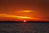 Sunrise down the Bay of Quinte under orange skies 2020 March 28.