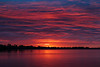 Shortly before sunrise purple sky reflected in the Bay of Quinte at Belleville Ontario 2020 May 31