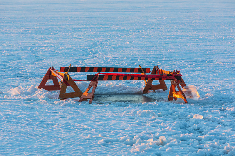 Protected hole in the ice on the Bay of Quinte